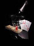 Playing cards and a bottle of champagne in bucket Stock Image