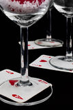 Playing cards at the bottom of the glasses Royalty Free Stock Photos