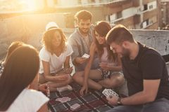 Playing cards on a building rooftop royalty free stock images