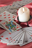 Playing cards and candle Royalty Free Stock Image