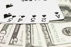 Playing Cards and Cash Stock Images