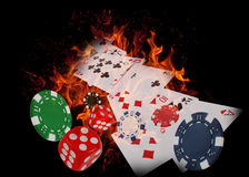 Playing cards and casino chips on fire. poker concept Stock Photo