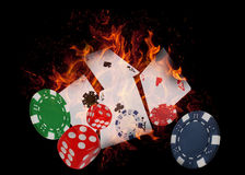 Playing cards and casino chips on fire. poker concept Stock Photos