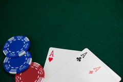 Playing cards and casino chips on poker table Stock Photography