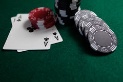Playing cards and casino chips on poker table Royalty Free Stock Images