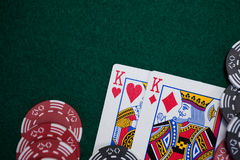 Playing cards and casino chips on poker table Royalty Free Stock Photography