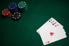 Playing cards and casino chips on poker table Royalty Free Stock Photo