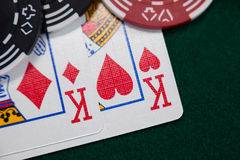 Playing cards and casino chips on poker table Stock Photo
