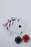 Playing cards and casino chips on white background Royalty Free Stock Photos