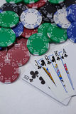 Playing cards and casino chips on white background Stock Photo