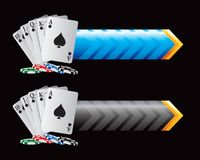 Playing cards and chips on blue and black arrows Royalty Free Stock Image