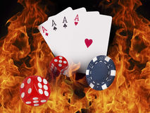 Playing cards and chips on fire. casino concept Royalty Free Stock Photos