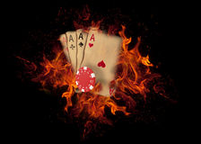Playing cards and chips on fire. casino concept Royalty Free Stock Photo