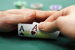 Playing cards and chips in hands Royalty Free Stock Image