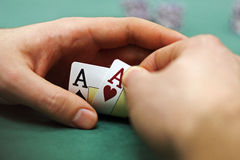 Playing cards and chips in hands Royalty Free Stock Photos