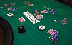 Playing cards and chips on a table Stock Photo