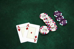 Playing cards and chips on a table Stock Images