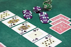 Playing cards and chips on a table Royalty Free Stock Images