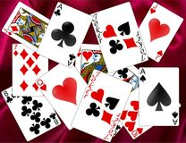 Playing cards. Classic playing cards on the purple silk background Royalty Free Stock Images