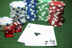 Playing cards Clubs Dice Poker chips Stock Image