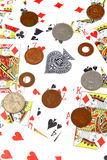 Playing cards and coins Royalty Free Stock Photography