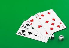Playing cards on cololur broadcloth. Royalty Free Stock Photography
