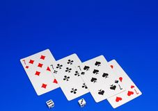 Playing cards on cololur broadcloth. Royalty Free Stock Photos
