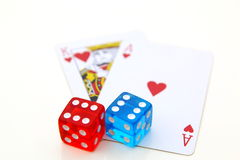 Playing cards and color dices Royalty Free Stock Image