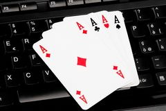 Playing cards on computer keyboard Royalty Free Stock Photos