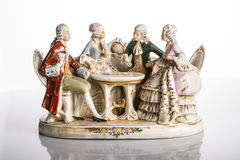Playing cards- decorative porcelain sculpture. Decorative sculptural group Cards game. Painted porcelain. Made in Germany, in 1920 - 1960. Two men and two women Royalty Free Stock Photo