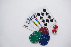 Playing cards, dice and casino chips on white background. Playing cards, dice and casino chips arranged on white background Royalty Free Stock Photography