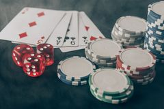Playing cards with dice and chips stock image