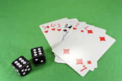 Playing cards, dice on cloth Stock Image