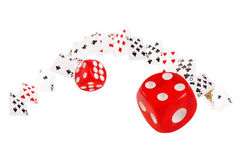 Playing cards and dice flying  on white background Royalty Free Stock Photos