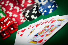 Playing Cards, dice and Poker chips Stock Photos