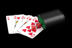 Playing cards, dices and cup. Close up of flash royal and dices. Concept of addiction stock photography
