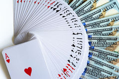 Playing cards and dollars. Fan-shaped playing cards of  hearts suit and dollars Stock Photos