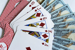 Playing cards and dollars Royalty Free Stock Images