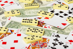 Playing cards, dominoes and money Royalty Free Stock Image