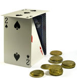 Playing cards and euro coins. Playing cards doing a litle house and several euro coins stock images