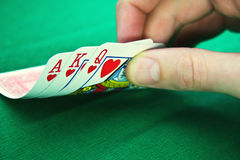 Playing cards and fingers Stock Photos