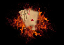 Playing cards on fire. casino concept Royalty Free Stock Photos
