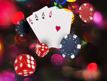 Playing cards flying. Playing cards and chips flying at bright background Royalty Free Stock Image