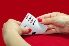 Playing Cards. Aces. Red background Stock Photos