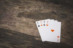 Playing cards four aces on the wooden table stock photos