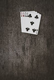 Playing cards four five closeup on a wooden table. space for text. copyspace. Royalty Free Stock Photography