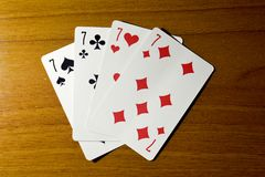 Playing cards, four sevens on the table. For the casino royalty free stock photo