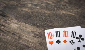 Playing cards four ten with copyspace. On the wooden table game abstract Royalty Free Stock Photography