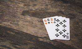 Playing cards four ten with copyspace. On the wooden table game abstract Royalty Free Stock Photos