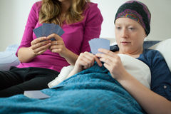 Playing cards with friend with cancer Royalty Free Stock Image